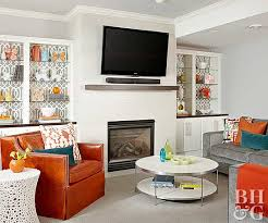 where to place tv in living room with fireplace tvs over fireplaces better homes gardens