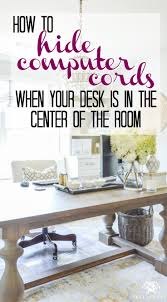 hide computer cords when your desk is in the center of the room
