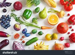 rainbow colored fruits vegetables on white stock photo 497140153