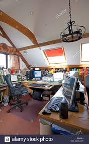 home based it computer office above garage in cotswold house stock