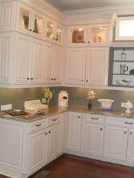 Kitchen Display Cabinets Closing The Space Above The Kitchen Cabinets Moldings Kitchens