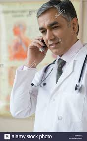 Mobile K He Doctor Talking On A Mobile Phone Stock Photo Royalty Free Image