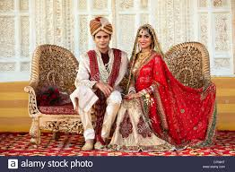 indian wedding groom indian and groom in traditional wedding dress sitting on a