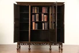 dutch hand carved oak 1910 antique bookcase wavy glass doors from