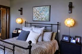Using Laminate Flooring On Walls Grey Wall Paint Decoration With Wall Lights And Black Bedstead