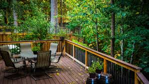 Drysnap Under Deck Rain Carrying System by Pvc Deck With Cedar Railing And Metal Balusters Pvc Decking