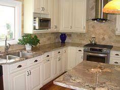 White Cabinets With Granite Countertops Santa Cecelia Granite - Kitchen colors with cream cabinets