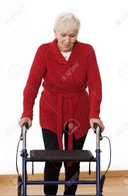 elder walker elder disabled woman is walking with walker stock photo picture