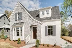stone and painted brick tudor blake shaw homes atlanta athens