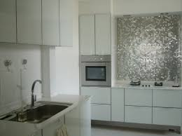 interior modern white kitchen design with metal tiles backsplash