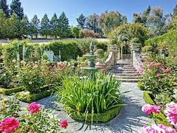 traditional landscape and yard with water feature