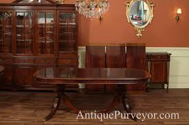 mahogany dining room table with leaves seats 12 14 people matching cabinets are available