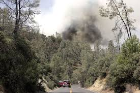 firefighters working on full containment of lake berryessa fire