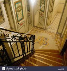 ornate wrought iron banister on stairs leading to small hall with