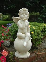 garden cherub on blowing a garden statue