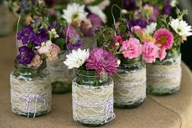 jar wedding ideas dahlias and purple allium in burlap wrapped jars on a