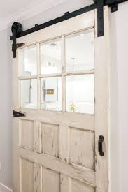 carriage style door on barn sliding track as master bath entry