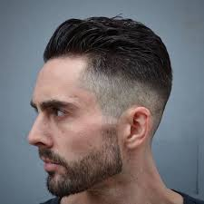 hair i woman s chin sideways undercut fade close up of man with black and grey hair with