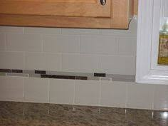 subway tile backsplash ideas for the kitchen offset white ceramic subway tile with black and white linear glass