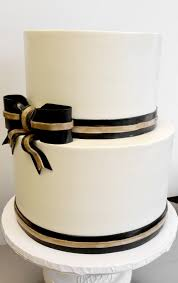 black and gold ribbon wedding cake with fondant black and gold ribbon detail 2