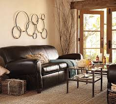 awesome retro living room with dark leather sofas beside rattan