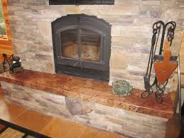 brick stone fireplace with black metal fire box on ceramics