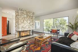 modern eagle rock midcentury with statement fireplace asks 799k