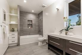 contemporary bathroom with built in bookshelf wall sconce