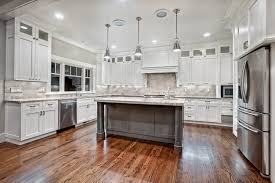 Cabinet Designs For Kitchen Awesome Varnished Wood Flooring In White Kitchen Themed Feat