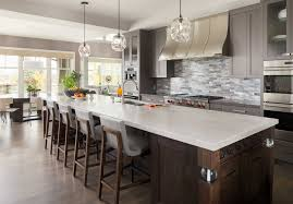 an elegant calgary home inspired by big sky country western living handmade glass tile by vancouver s edgewater studios lines the kitchen backsplash