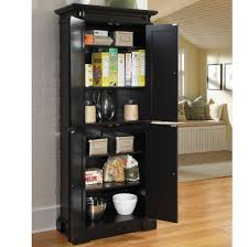black pantry storage cabinet with four doors upper and bottom