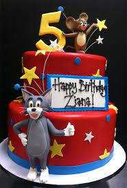 splendid tom and jerry 5th birthday cake between the pages