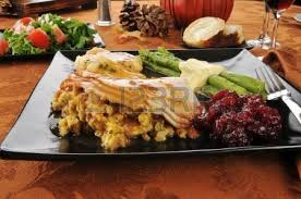 turkey and dressing with asparagus and cranberry sauce stock photo
