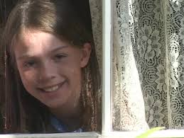 sandra orlow childhood pictures a girl looks through lace window curtains stock footage video