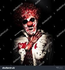 deathly scary halloween background pics evil portrait creepy clown getting chocked stock photo 116801455