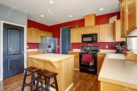 Kitchens With Island by Small Kitchen With Island Also Red And Gray Walls Stock Photo