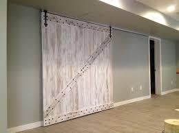 basement renovation kitchen gym wine cellar and a barn door