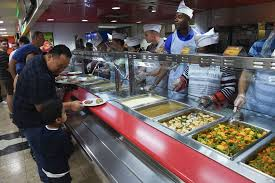 volunteers serve thanksgiving lunch in bahrain middle east stripes