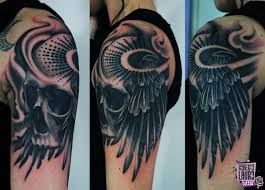 Skull Arm - skull with wings on arm tattoos