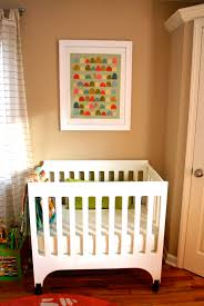 floor and decor ta bedroom white crib by babyletto on wooden floor matched with