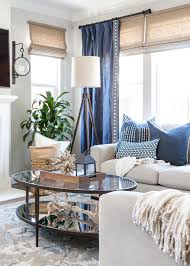 coastal family room blue and white pillows gray walls roman