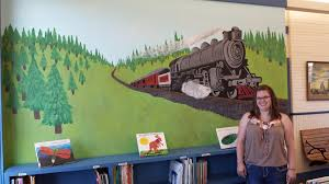 library gets mural in honor of chad jordan the cavalier county extra mural at library