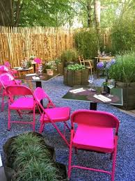 pink chairs for summer backyard party decoration with bamboo