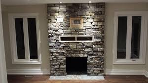 classic stone veneer fireplace design idea with wooden shelf also