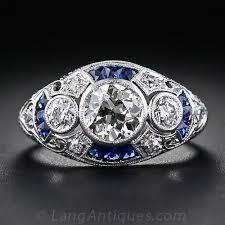 1 05 carat art deco diamond and calibre sapphire ring
