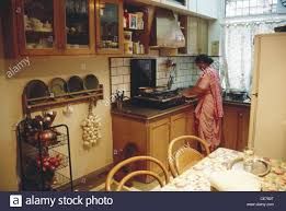 rsc 84774 woman cooking food in kitchen higher middle class