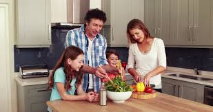 happy family having their breakfast together at home in the