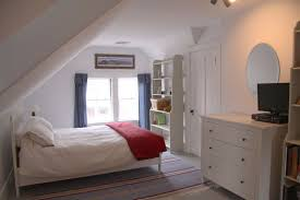 cottage guest bedroom with hardwood floors u0026 attic ceiling in