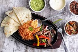 cuisine salsa portrait of cuisine fajitas served with flour