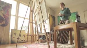 sofia minson painting an oil portrait of an old woman in her art